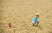 Planting Seedlings. Child Having Fun With Little Shovel And Plant In Pot. Planting In Field. Little  poster