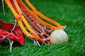 Girls Lacrosse stick scooping up the ball