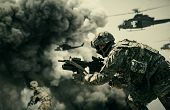 Military Helicopter And Forces Between Fire And Dust In The Battlefield poster