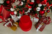 Decorated Gift Boxes Under The Christmas Tree. Presents Under The Christmas Tree On Floor poster