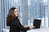 Pretty business woman at office desk