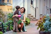 image of congrats  - Little boy giving flower to his mom on mother - JPG