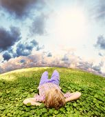 Lying On Green Grass Carefree Little Boy