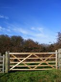 Rural Wooden Five Bar Gate Against Blue Sky