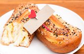 Delicious Breads With Sesame And Card Bank Paper And Hearts On The Clothesline