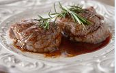 Filet mignons on a plate with rosemary
