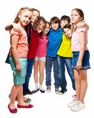 foto of semi-circle  - Group of happy 10 years old boys and girls standing together in semi - JPG