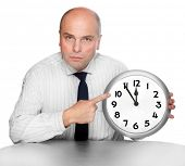 An businessman with a clock face. Time is money concept.