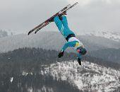BUKOVEL, UKRAINE - FEBRUARY 23: Sergei Berestovskiy, Belarus performs aerial skiing during Freestyle Ski World Cup in Bukovel, Ukraine on February 23, 2013