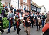 HASTINGS, ENGLAND - MAY 7: Musicians parade through the Old Town during the annual Jack In The Green festival on May 7, 2012 in Hastings, East Sussex. The event marks the May Day public holiday.