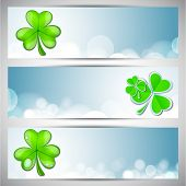 Website header or banner set for St. Patrick's Day celebration with shamrock leaves.