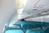 Blue Seats In White Passanger Airplane