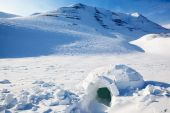 image of igloo  - Igloo in a winter mountain setting cold shelter - JPG