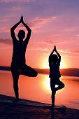 Meditating At Sunrise Together