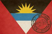 Welcome to Antigua and Barbuda flag with passport stamp.