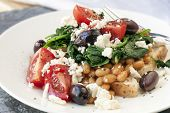 Healthy baked beans on wholewheat toast, with wilted spinach, feta, tomatoes and black olives.