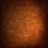 abstract orange background with black grunge border texture