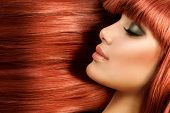 Healthy Long Straight Hair. Red Hair Model Girl Portrait. Sexy Woman Face with Long Shiny Straight Red Hair. Fringe Hairstyle. Hair Extensions
