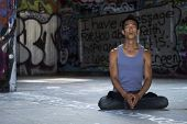 Young man meditating