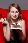 a Cheerful woman eating chocolade a pie