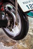 Wheel Motorcycle Washing With Water Pressure.