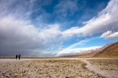 Couple Walking To A Rainbow In Death Valley