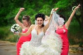 Happy bridesmaids enjoying with bride