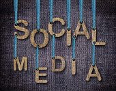 stock photo of sackcloth  - Social Media etters hanging strings with blue sackcloth background - JPG