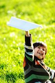 stock photo of dimples  - Happy kid enjoying sunny late summer and autumn day in nature on green grass - JPG