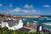 Blue sky and white waves St Ives Cornwall England