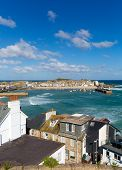 View of St Ives Cornwall England with harbour, boats and blue sea and sky