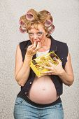 foto of redneck  - Pregnant hillbilly female indulging in box of candy - JPG