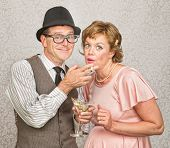 stock photo of gullible  - Expecting couple smoking cigarettes and drinking alcohol - JPG