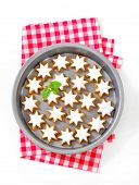 Cinnamon star cookies glazed with frosting