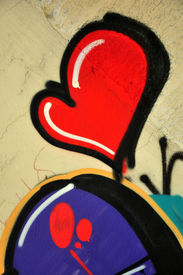 stock photo of street-art  - Colorful heart graffiti on a street wall - JPG