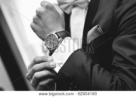 Man with suit and watch on hand poster