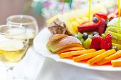 Plate with fruit and glass of champagne