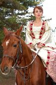 Beautiful Girl In Antique Dress On Horseback