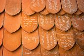 Ayuthaya, Thailand - 22 Nov 2013: Names Written In Chalk On Clay Tiles - Old Eastern Tradition