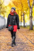 Portrait Of Beautiful Red-haired Young Woman Walking In Autumn Park