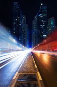 Long exposure of moving cars on night road in modern city Dubai