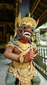 stock photo of garuda  - balinese god from bali temple in green wear - JPG