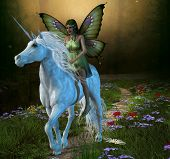 stock photo of fairyland  - A fairy rides a white unicorn down a path in the magical forest - JPG
