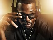 stock photo of rapper  - dj smoking and wearing sunglasses - JPG