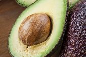 Ripe Halved Avocado On Plate. Closeup.