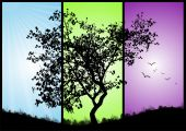 black tree on a colorful background