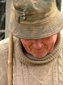 Old Man With A Hat And A Walking Stick