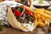 image of gyro  - Homemade Meat Gyro with Tzatziki Sauce tomatos and French Fries