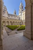 Mafra, Portugal - September 02, 2013: North Cloister of the Mafra National Palace, Convent and Basilica. Franciscan Religious Order. Baroque architecture.
