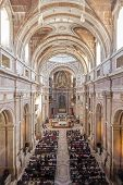 Mafra, Portugal - September 02, 2013: Basilica of the Mafra Palace filled with faithful during the M